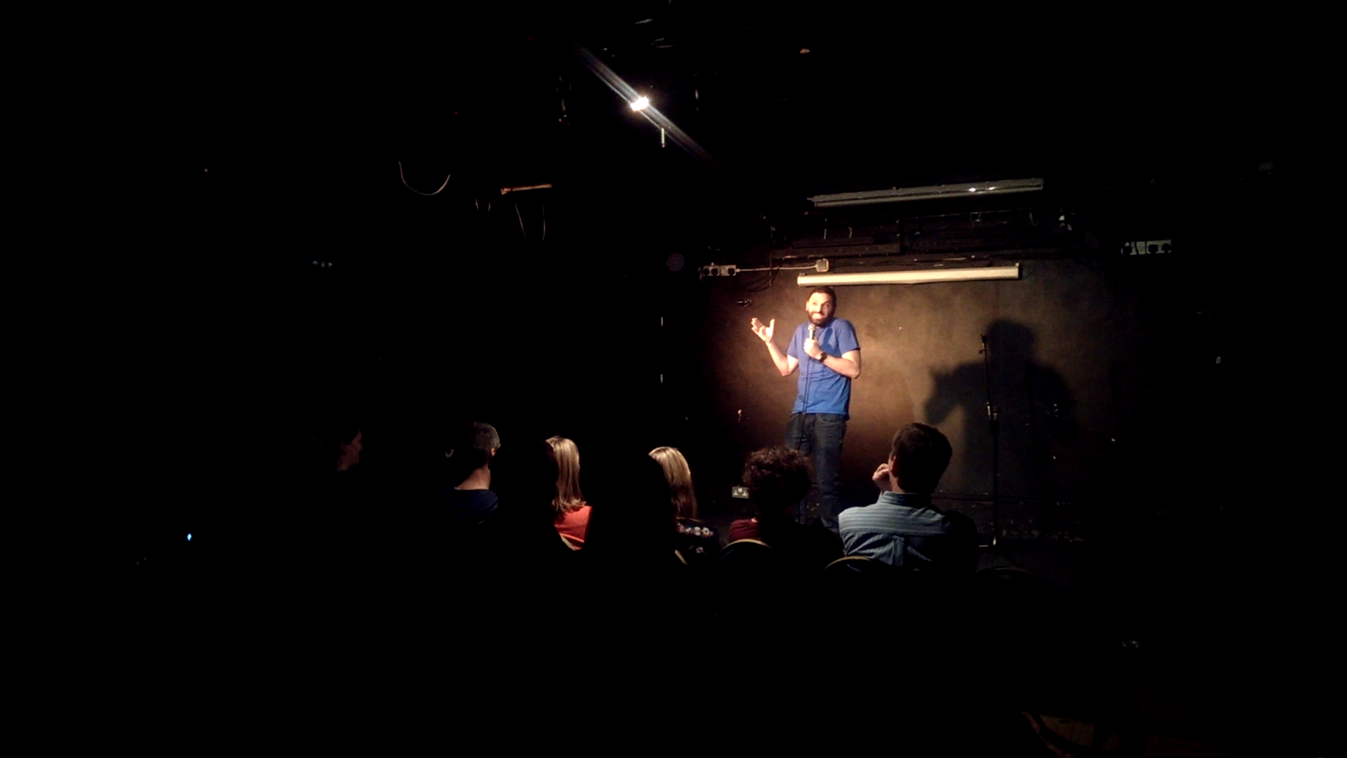 Louie performing stand-up comedy at Hoopla Comedy club photo 2015